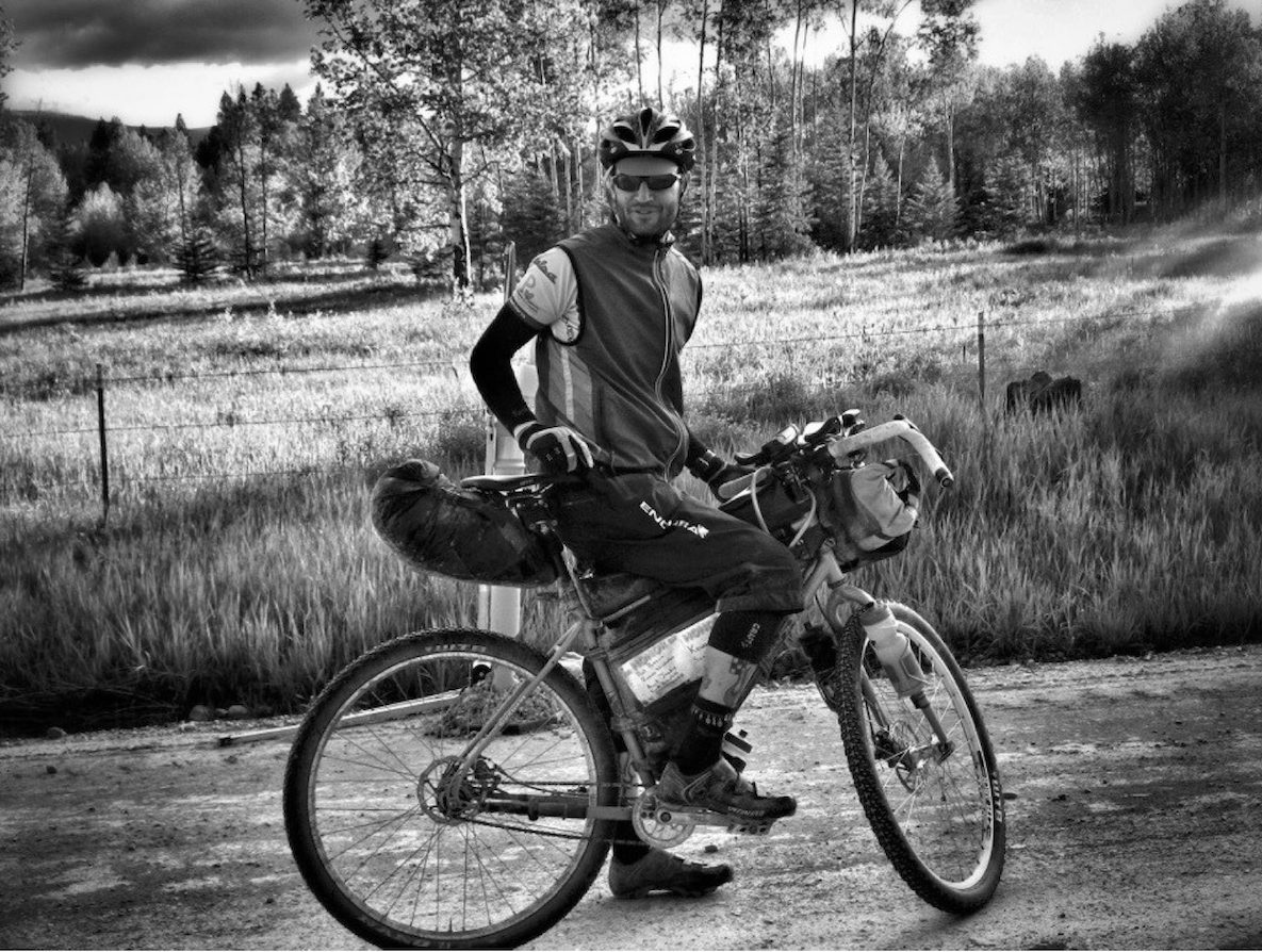 Erik on the Tour Divide. Photo by Adam Guske.
