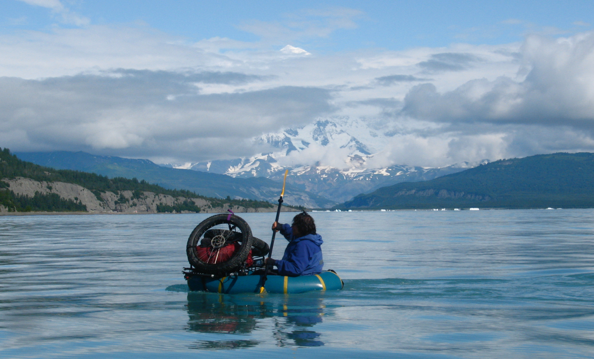 Dylan Kentch paddling across Icy Bay, Alaska, with Mount St. Elias in the background. Photo by Eric Parsons.